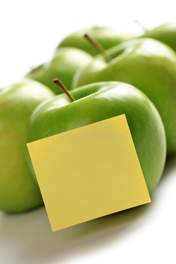 Green Apples And Notepaper Royalty Free Stock Photos
