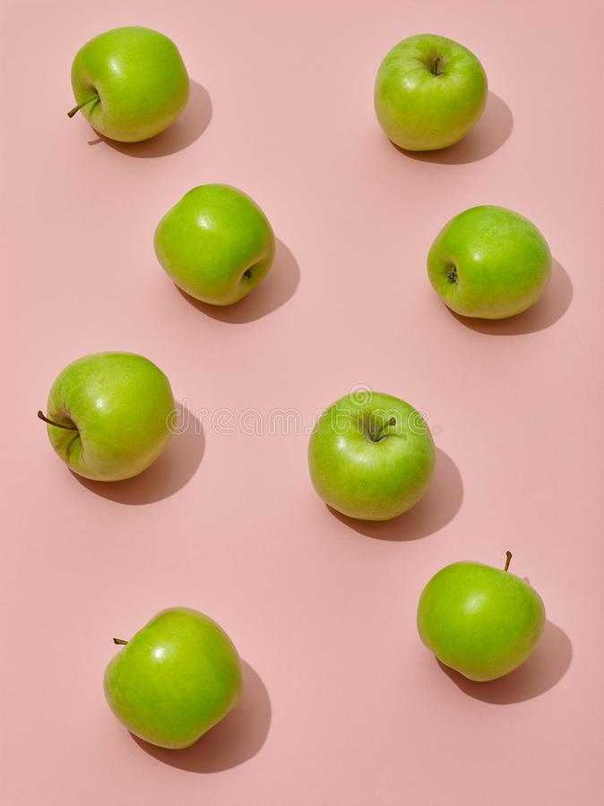 Green apples on pink background royalty free stock images