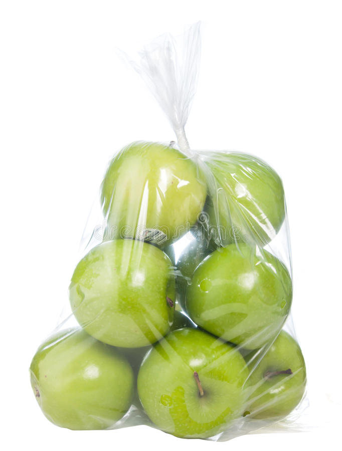 Green apples in plastic bag. On white background stock image