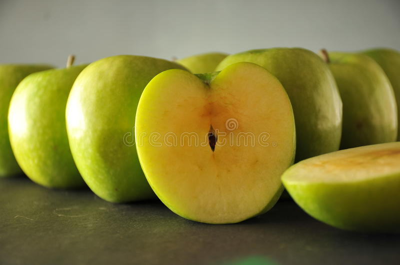 Green apples in row royalty free stock photography