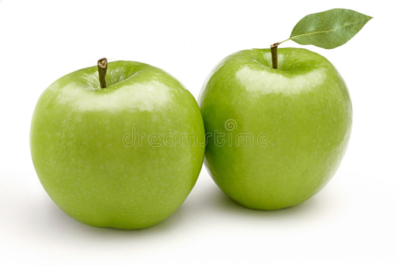 Green apples. On white background royalty free stock photography