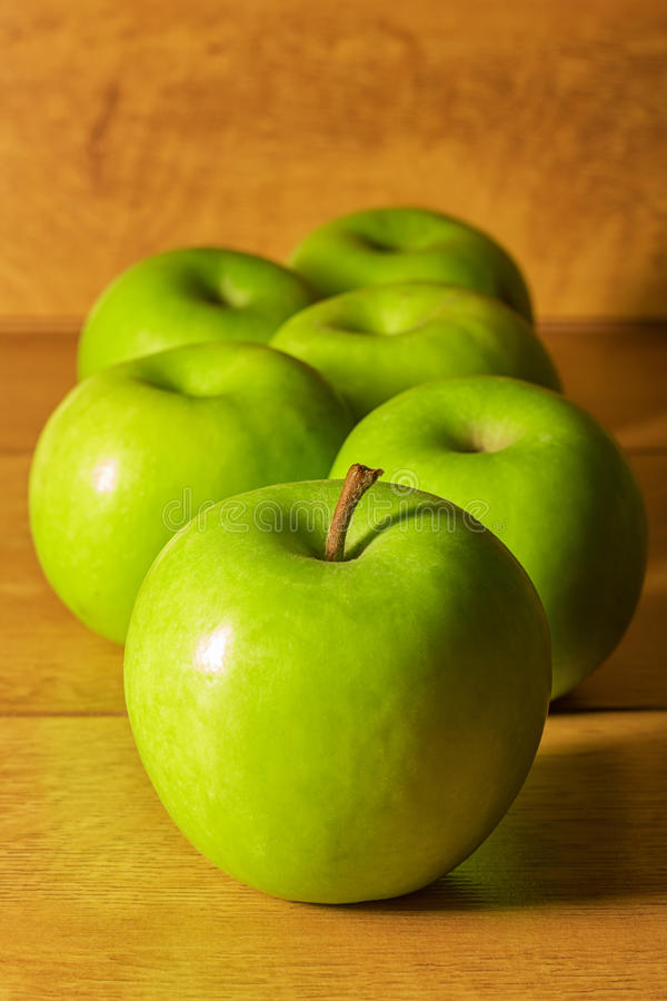 Green apples. On a wooden table stock photography