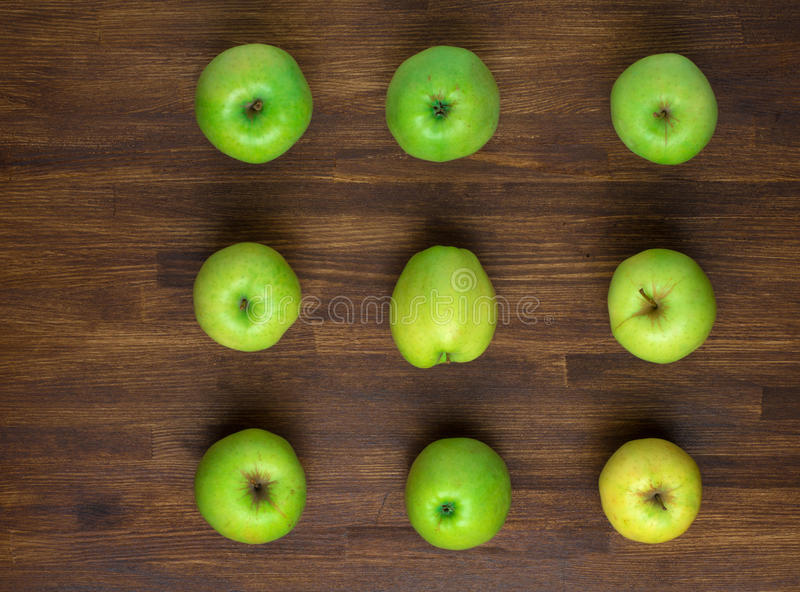 Green appples on dark wooden background. Top view.  stock photos