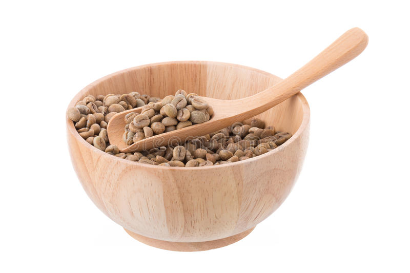 Green Arabica coffee beans in a wooden bowl Isolated on a white royalty free stock photos
