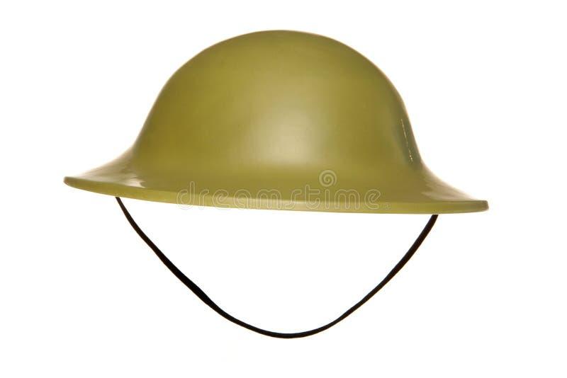 Green army fancy dress helmet. Studio cutout stock images