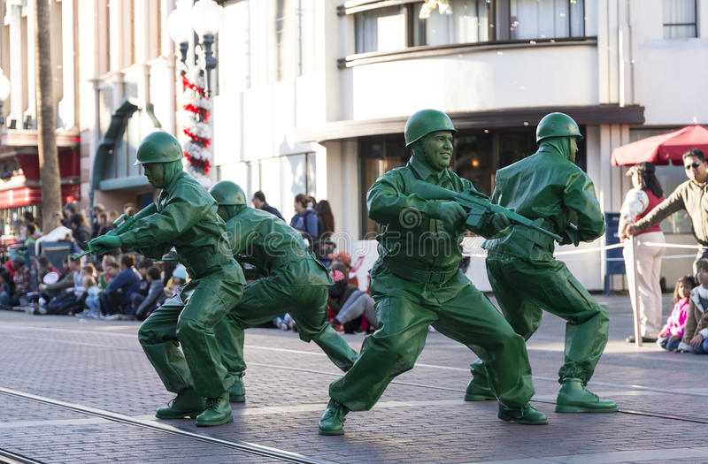 Green army men. Disney's green army men parading on the street royalty free stock photography