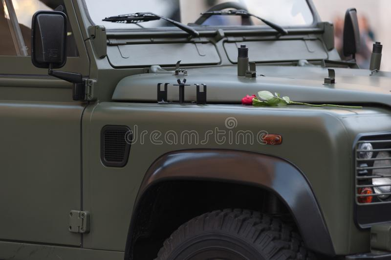 Green Army Soldier Jeep with Red Rose at Outside Rome Italy. Green Army Soldier Jeep with Red Rose at Outside in Rome Italy stock photos