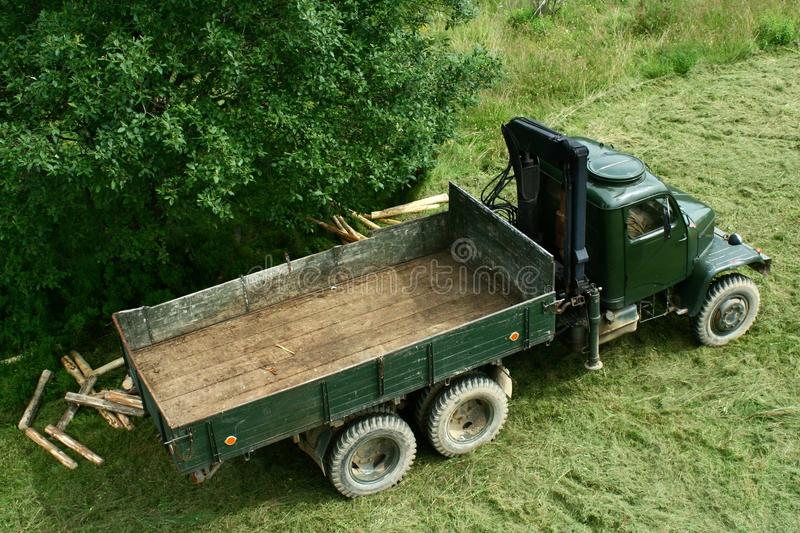 Green army truck from 1950s modified for timber transport. Green army truck modified for timber transport. Captured from above stock image