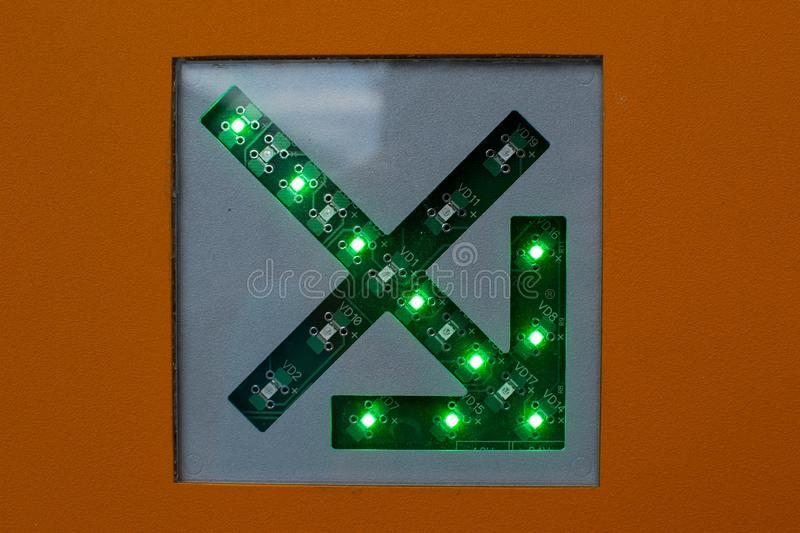 Green arrow on a circuit diagram close up stock image