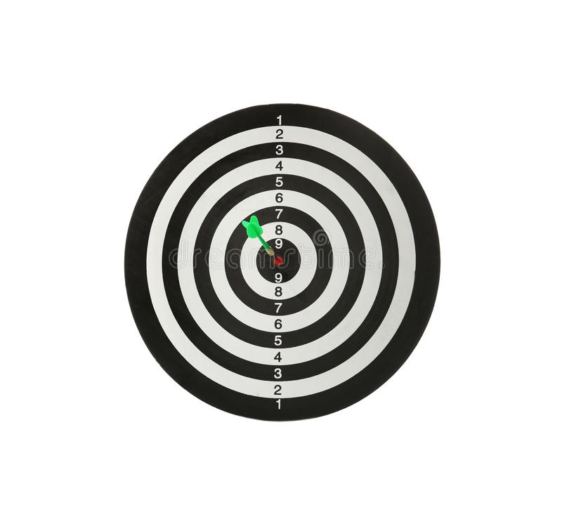 Green arrow hitting target on dart board. Against white background stock photos
