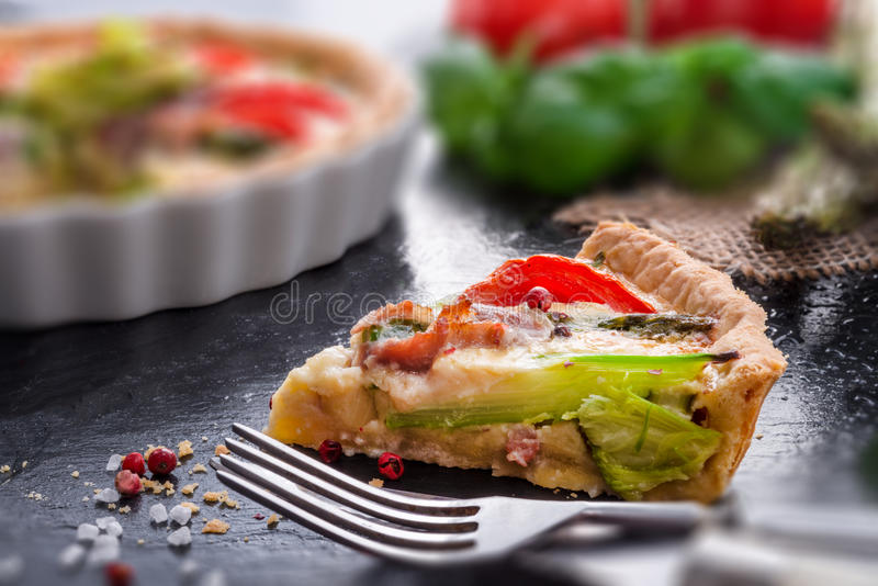 Green asparagi Tart with eggs and tomato. A green asparagi Tart with eggs and tomato royalty free stock photography