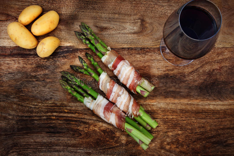 Green asparagus with bacon and potatoes royalty free stock image