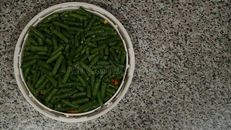 Green asparagus beans in white container stock photo
