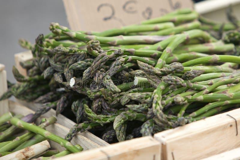 Green asparagus in box at farmers market