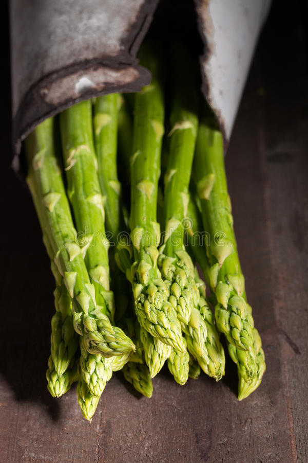 Green asparagus on dark wooden background stock photography