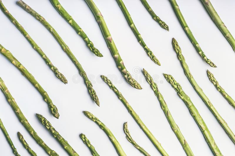 Green asparagus pattern on white background, top view, flat lay. royalty free stock photo