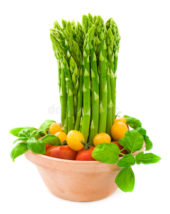 Download Green Asparagus With Tomatoes And Basil Stock Image - Image: 24914861