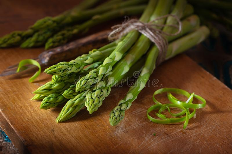 Green asparagus on a wooden plate stock image