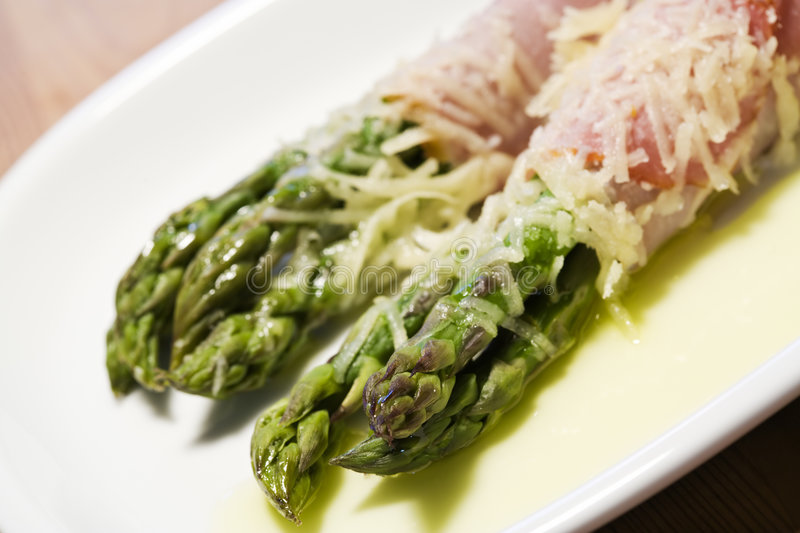 Green asparagus wrapped in ham stock photography