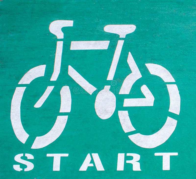 A start of cycle way painted on an asphalt surface stock image