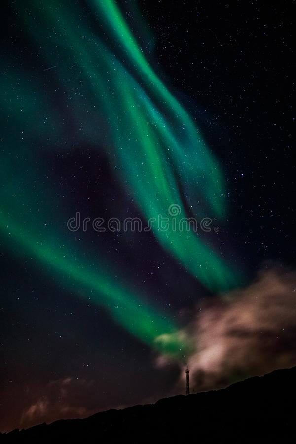 Green Aurora Borealis Northern lights shining with starlit sky, Nuuk, Greenland. Antenna, arctic, astronomy, backgrounds, beauty, bright, climate, clouds, cold royalty free stock photos