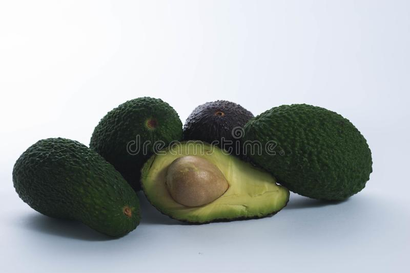 Green avocados on white background stock photography