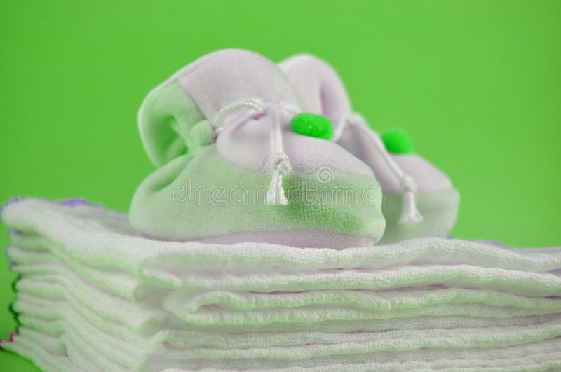 Download Green Baby Shoes On Cotton Diapers Stock Photo - Image: 8141000