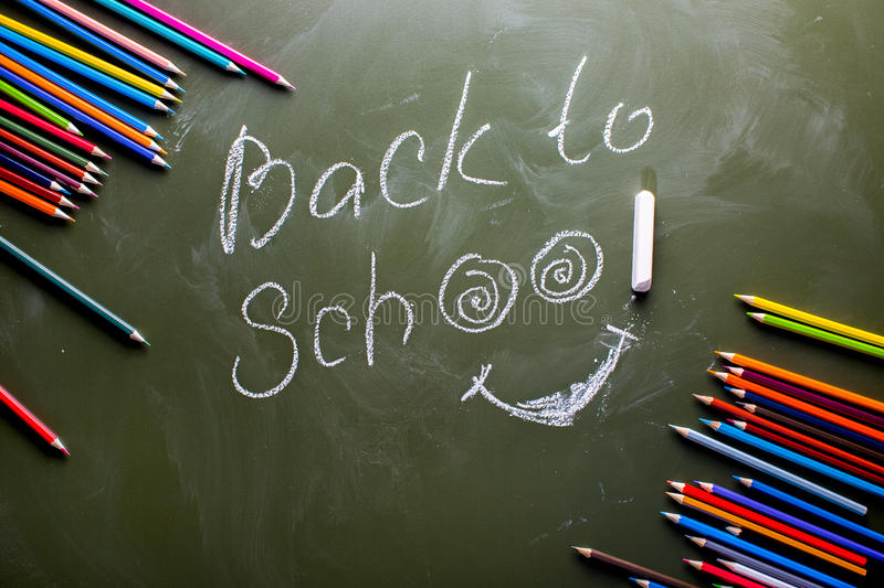 Green backboard label Back to school and a set of colored pencil. S. View from above royalty free stock images