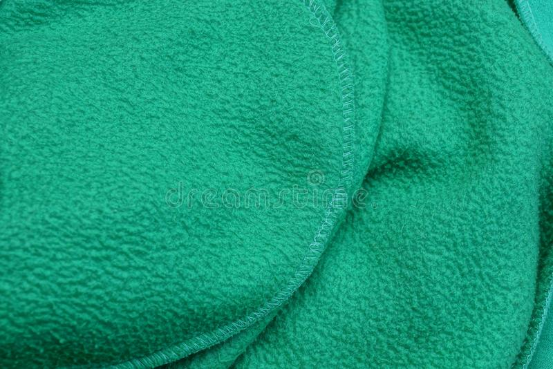Green fabric texture of crumpled fabric on clothes. Green background of crumpled fabric on clothes stock photography