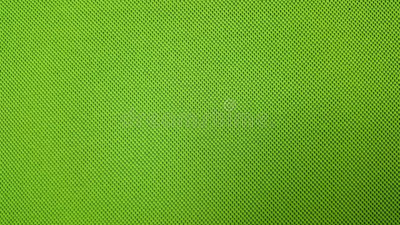 Green background textile material with pattern, closeup. stock image