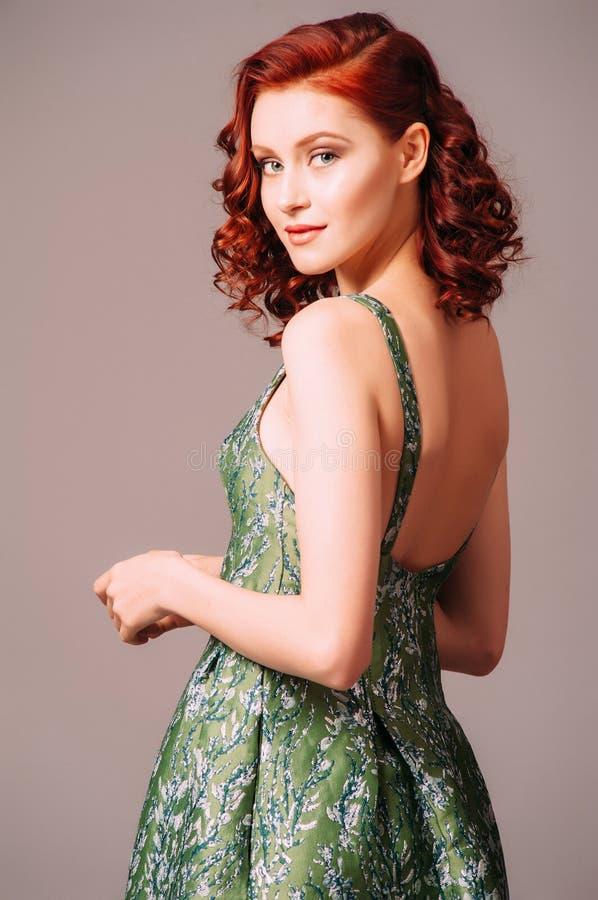 Free Green Backless Evening Dress. Beautiful Model Wearing Emerald High Heels, Modern Feminine Look Stock Images - 210034484