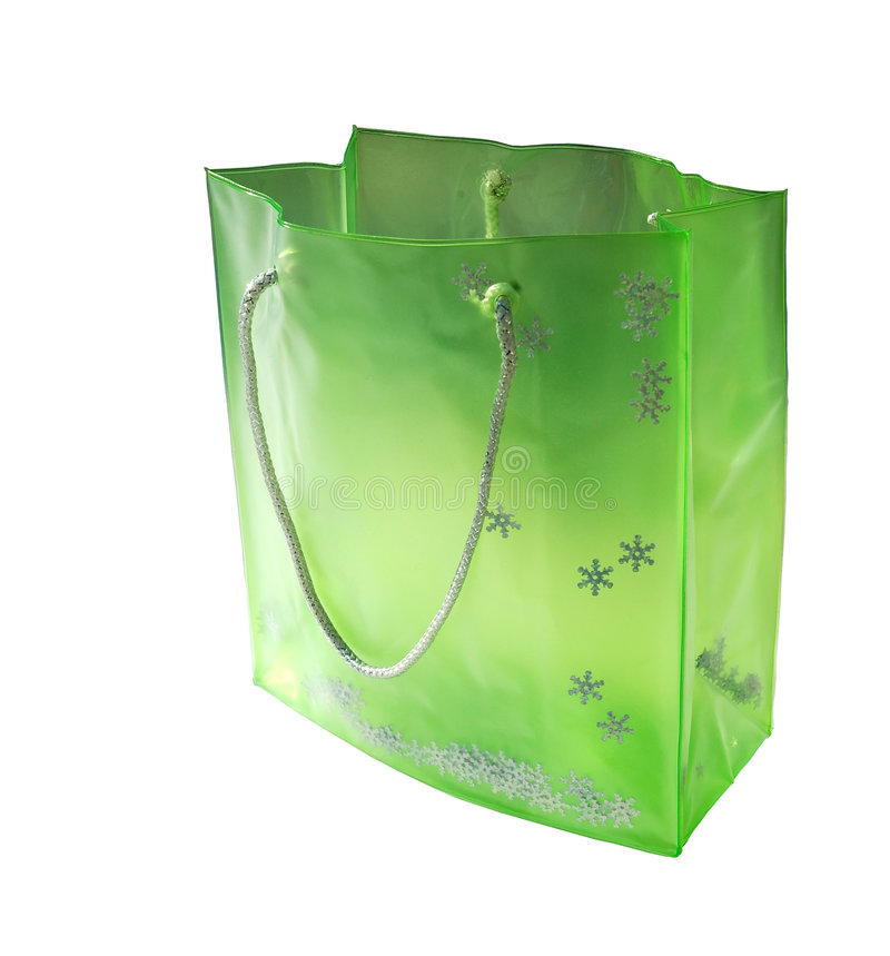 Green Bag. With silver snowflakes and handle. Isolated over white royalty free stock images
