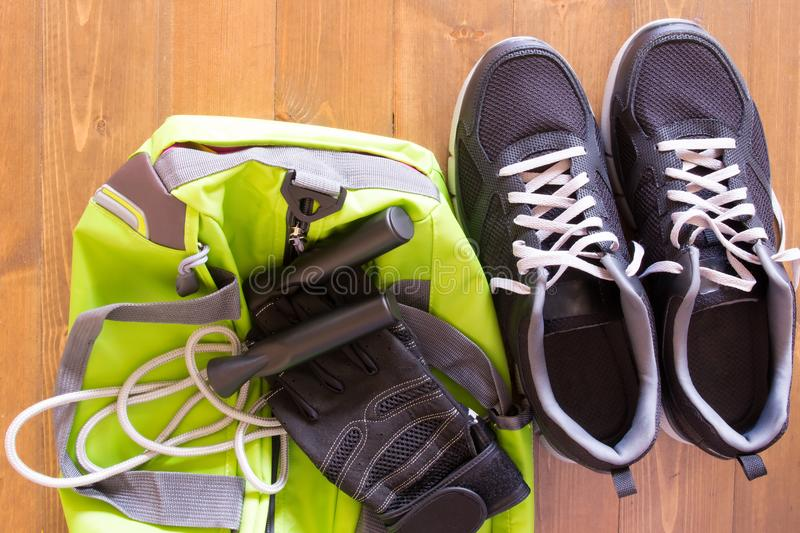 Green bag for sporting things on a wooden background royalty free stock image