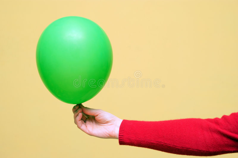 A Green Balloon In A Hand Stock Images