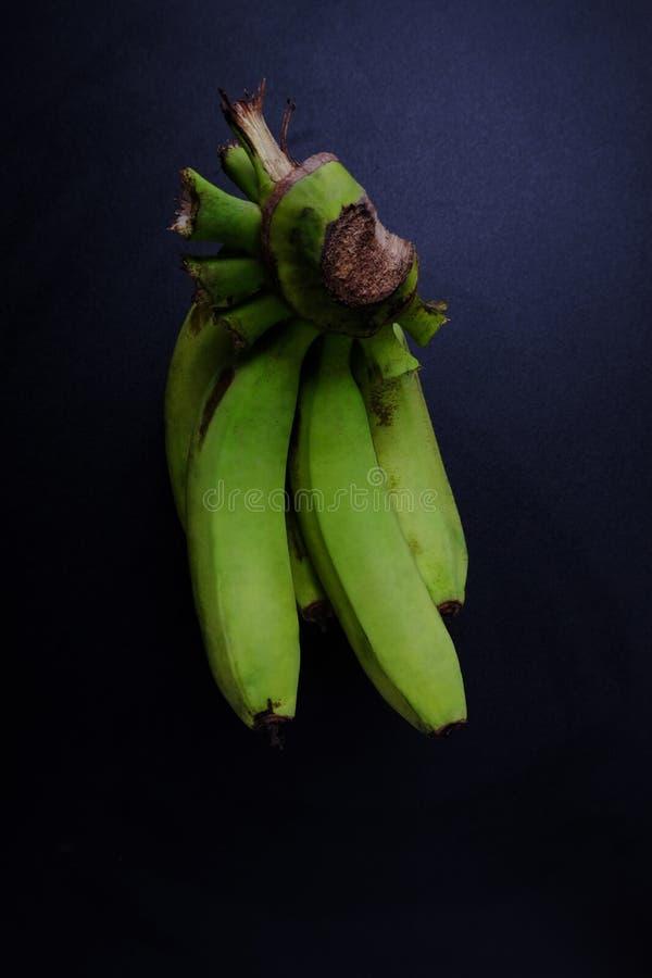 Green banana on table stock image