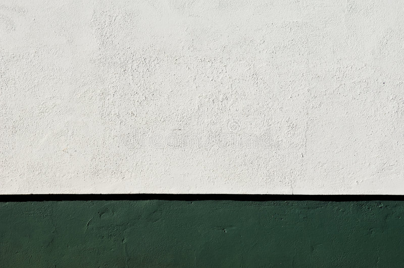 Green baseboard. Detail of white wall with a nice deep green baseboard stock images