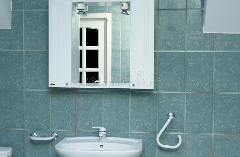 Green bathroom detail with mirror. Green bathroom detail with shell royalty free stock photos
