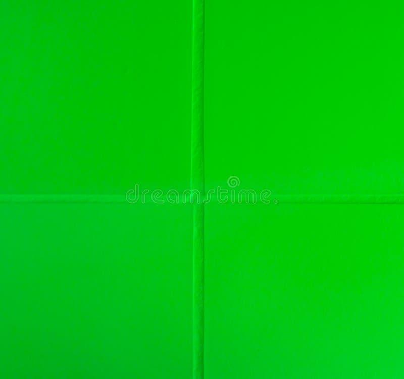 Green bathroom tiling texture macro closeup background. A modern Green bathroom tiling texture in macro closeup background royalty free stock image