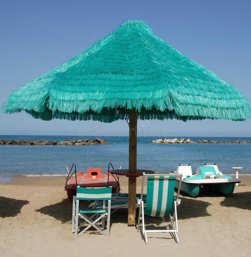 Download Green Beach Umbrella With Boats Stock Image - Image: 6485069