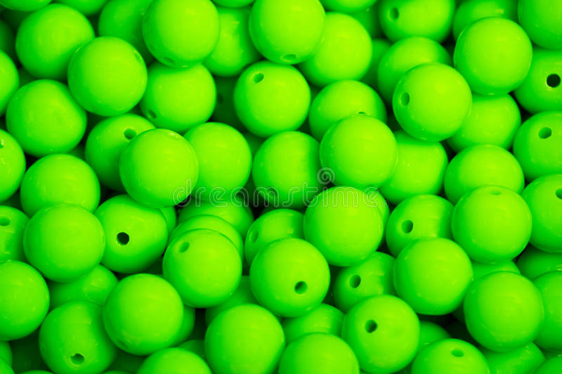 Green beads background stock photography