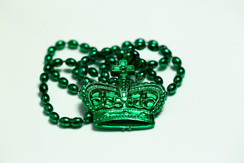 Green beads with crown on white royalty free stock images