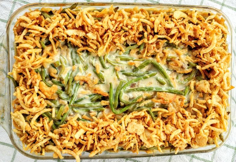 Green Bean Casserole, Thanksgiving, French Fried Onions. A traditional green bean casserole topped with French Fried Onions and cream of mushroom soup. Usually royalty free stock images