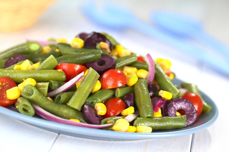 Green Bean Salad. Fresh vegetarian green bean salad with cherry tomatoes, corn, black olives and onion (Selective Focus, Focus one third into the salad stock photography