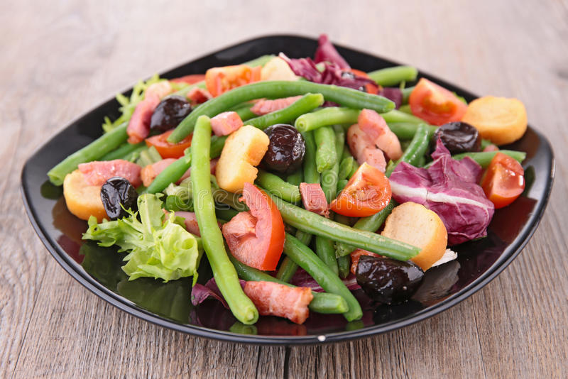Green bean salad. With bacon and tomato stock images