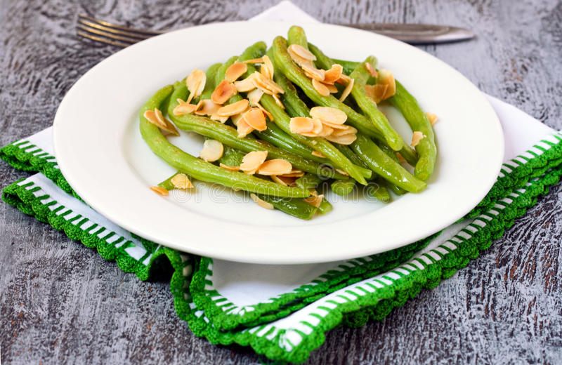 Green beans with almond. Served on a plate stock photography