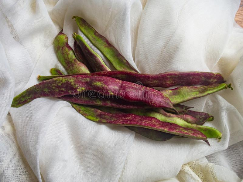 Green beans. On a cloth stock photo