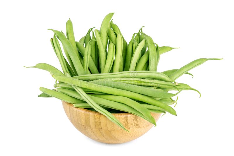 Green beans isolated in wooden bowl on a white background. Green beans isolated in wooden bowl on a white stock image