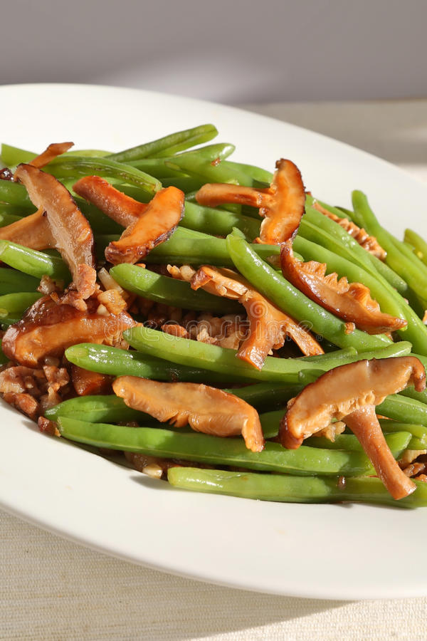 Green beans and mushrooms. Delicious green beans, mushrooms and ground pork on dish stock image