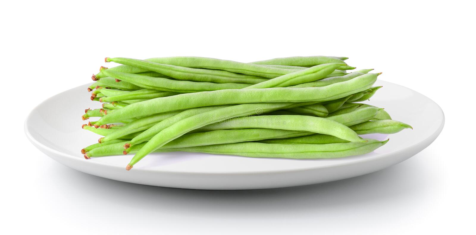 Green beans in a plate isolated on a white background. Green beans in a plate isolated on a white stock photo
