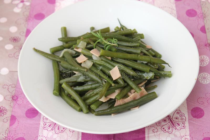 Green Beans. Some cooked green beans with pork sausage stock image